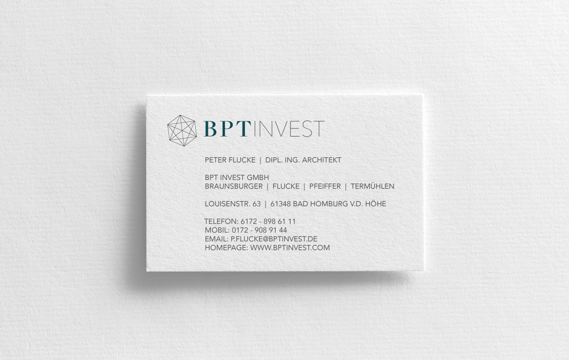 Mockup of two vertical business cards at white textured paper background.